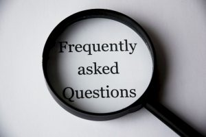 magnifying glass showing frequently asked questions