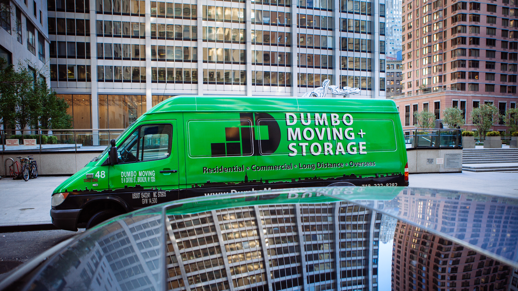 Dumbo Moving And Storage Green Van