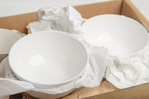 a fragile china packed in a moving box