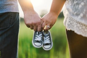 a couple holding crib shoes