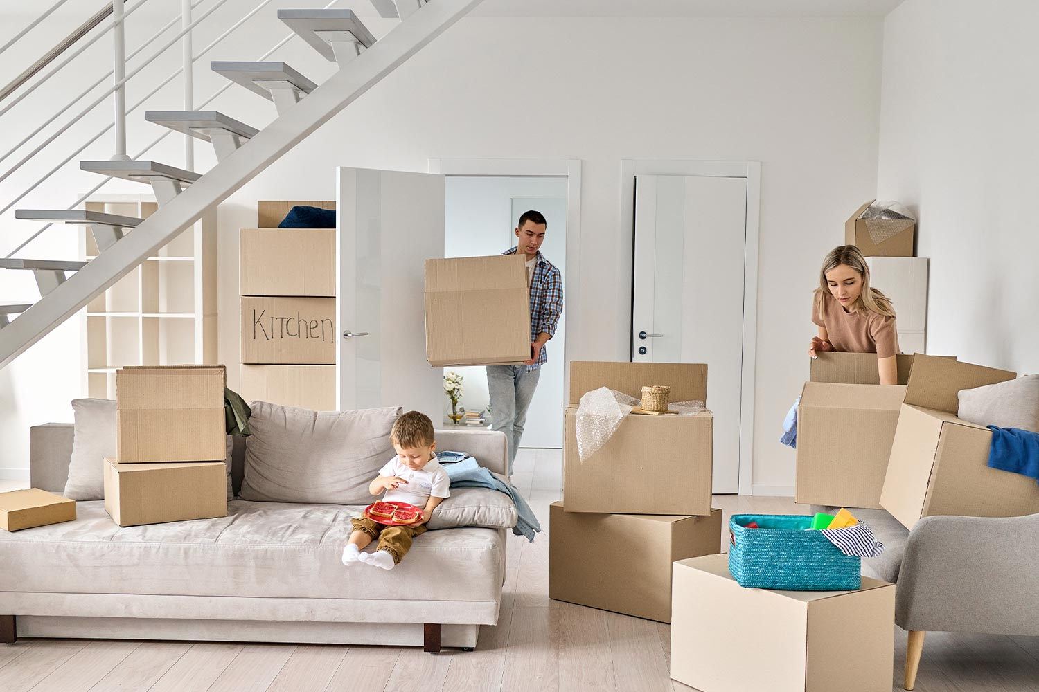 A Family Is Packing For A Move