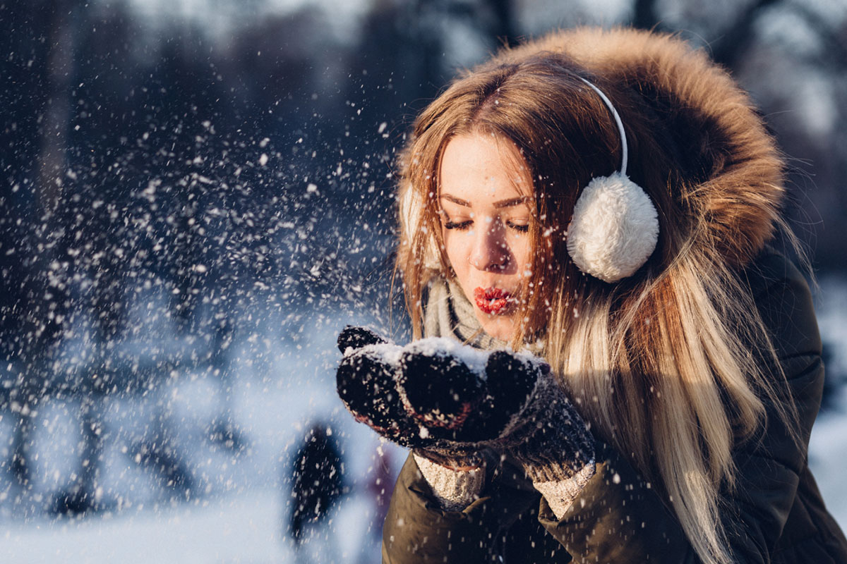 A Girl Blowing Snow after Move from NYC to Indiana in Winter