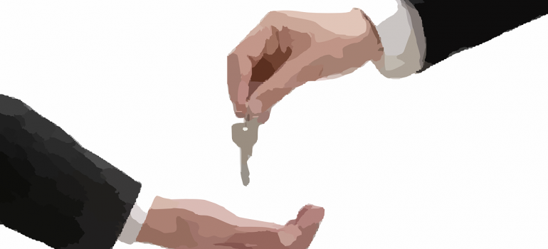 A sketch of one person giving keys to another one.