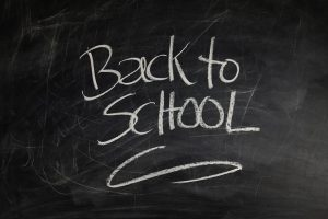 back to school sign on the blackboard