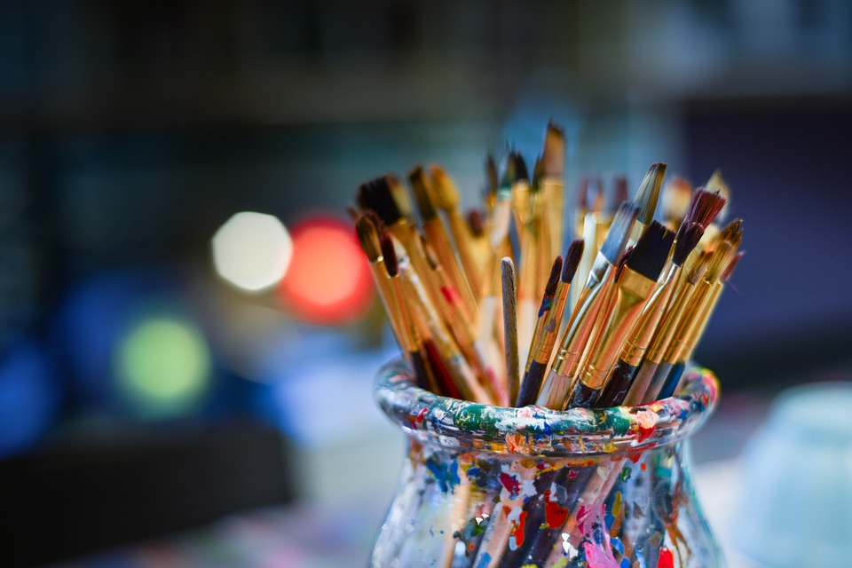 Paint brushes in a jar.