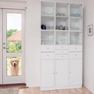 a white cabinet with the glassware inside