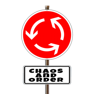 a red traffic sign with a chaos and order sign