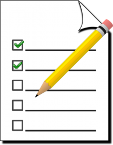 blank checklist and yellow pen