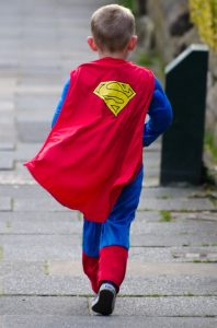 A boy dressed as a superhero.