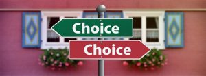 Pole with two signs facing opposite directions - it isn't always easy to make the right choice