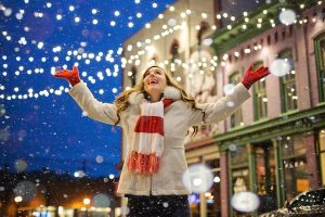 happy girl in a Christmas decorated town