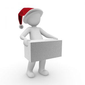 male model with a cap holding a box for the Christmas move