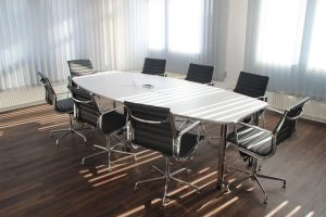 a conference table with eight chairs in an empty office before the office relocation