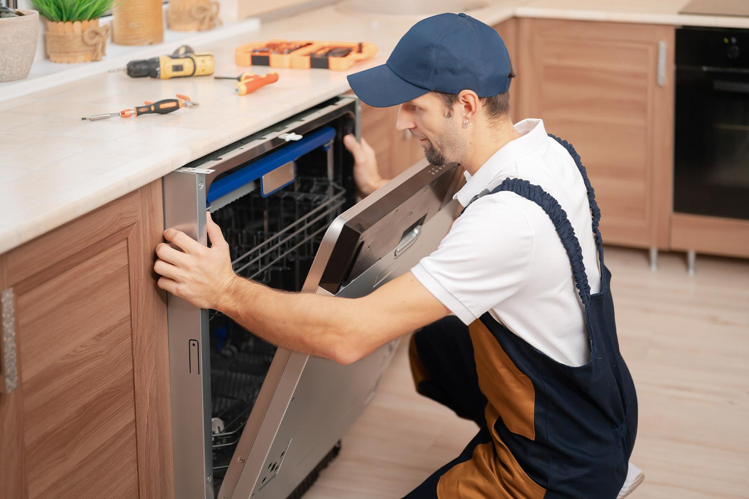 A mover disassembles a dishwasher