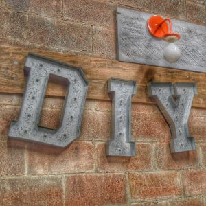 diy sign and a light bulb