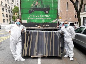 Dumbo movers move a couch to a moving truck