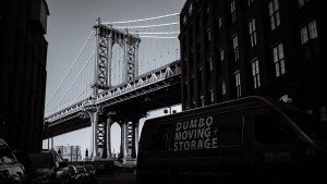 Dumbo Moving Company NYC truck in front of a bridge