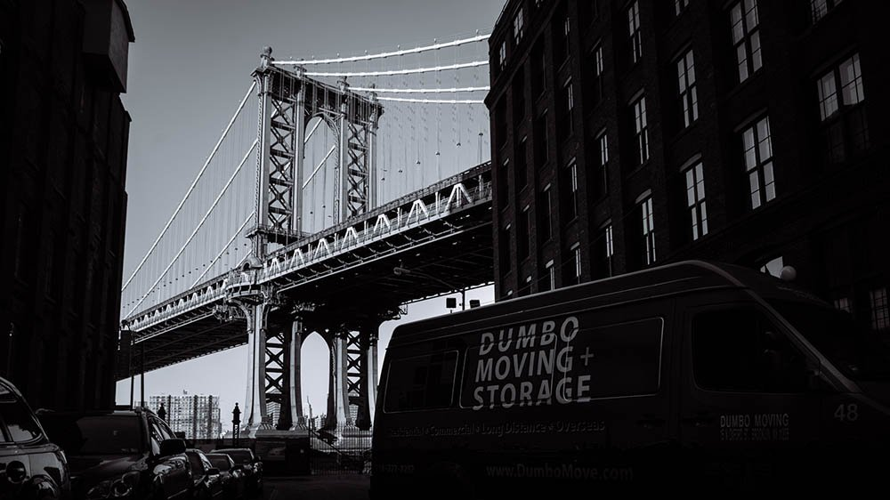 Bon Dumbo Moving Company NYC Truck In Front Of A Bridge