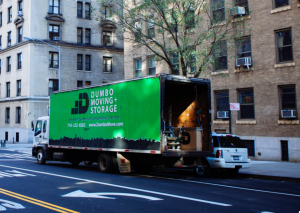 green Dumbo moving and storage truck