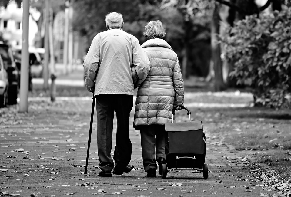 an elderly couple walking away
