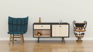 blue arm chair, wooden dresser and colorful jar