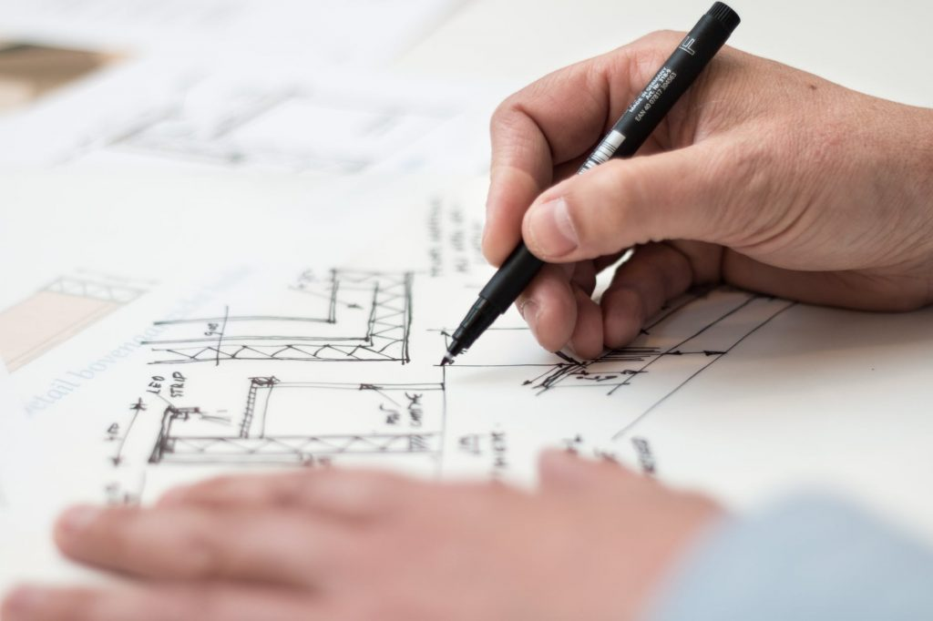 a man drawing a floor plan before setting up your new kitchen