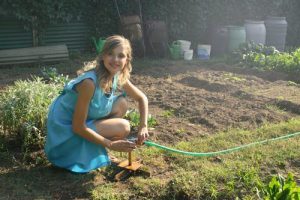 a woman in the garden after moving from an apartment to a house