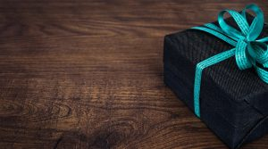 a wrapped gift with a blue ribbon