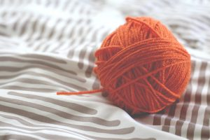 orange ball knitting wall on a soft surface