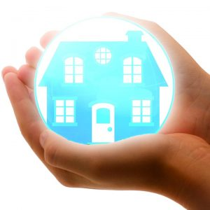 hands holding a home model in a bubble