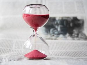 an hourglass with pink sand