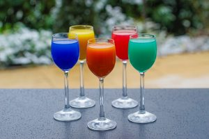five colorful drinks on a table served at a housewarming party at a housewarming party