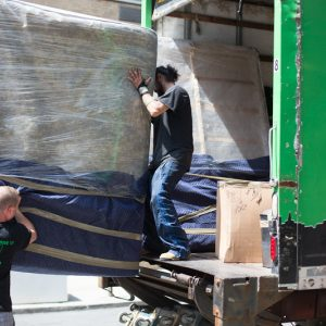 NYC Movers putting furniture in truck