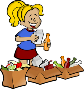 a girl making 3 piles of clutter