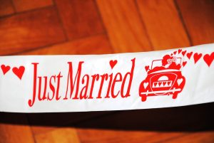a white band with a red just married message indicating some of the good reasons for moving