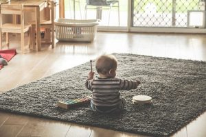 a toddler playing on the floor