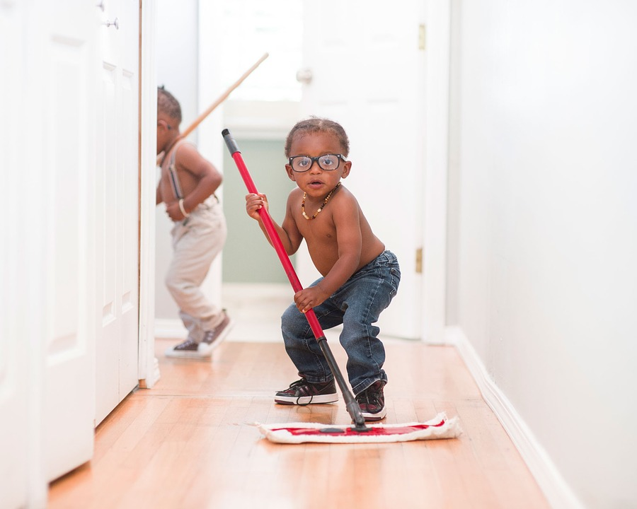 a child mopping floors
