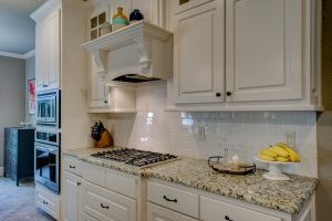 white kitchen cabinets are some of the most popular home features that sell homes quickly
