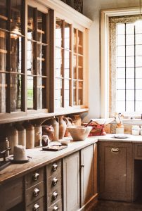 brown wooden kitchen cupboard is a starting point when handling food on moving day