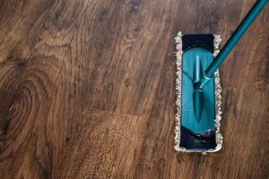 blue mop on a wooden floor