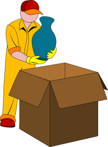 flat rate movers NYC wearing yellow clothes and putting items into moving boxes