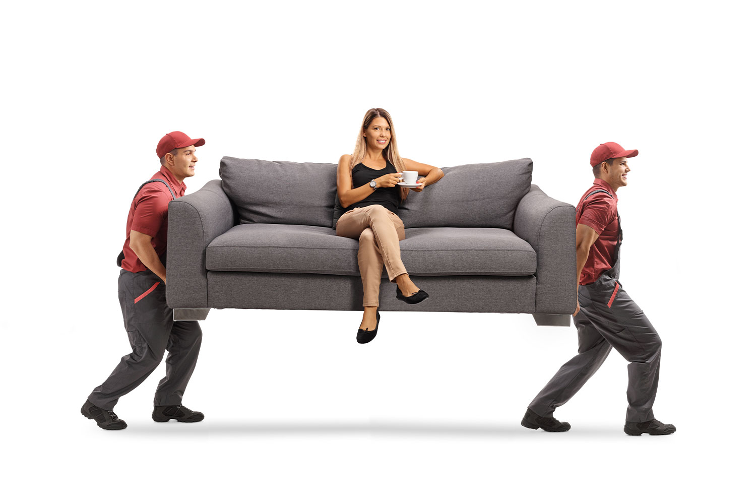 Movers carrying a couch with a girl on top