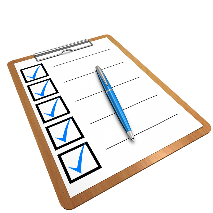 a blue pen on a moving and storage checklist