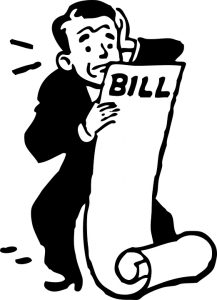 a worried man in black looking at his bill