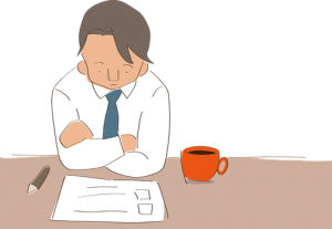 A man with a blue tie sitting in front of a cup of coffee and a moving out checklist