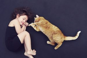 a girl and a cat sleeping