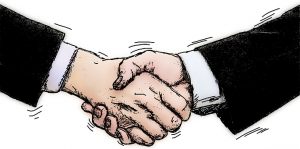 two shaking hands agreeing on moving services