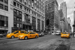 skyscrapers and yellow cabs on NYC streets