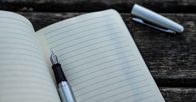 a notebook where to write down the list of the most stressful moving tasks
