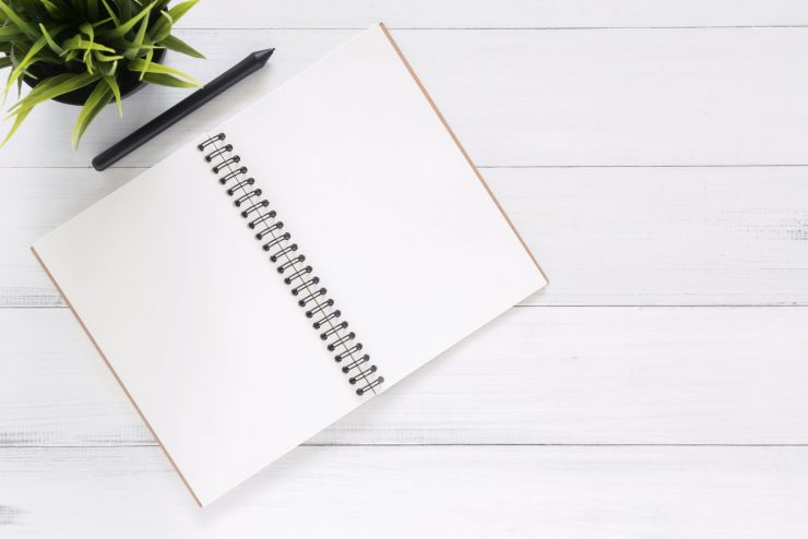 a blank notepad and a pen for time-saving moving tips